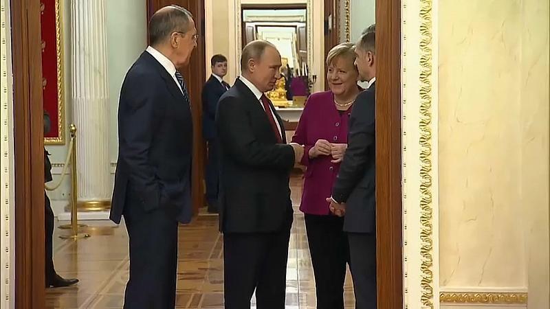 Putin und Merkel: